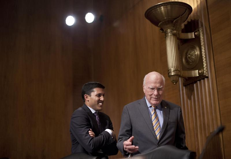 """Senate subcommittee on State, Foreign Operations and Related Programs Chairman Sen. Patrick Leahy, D-VT., right, talks with US Agency for International Development (USAID) Administrator Dr. Rajiv Shah on Capitol Hill in Washington, Tuesday, April 8, 2014, following the committee's hearing of the USAID's fiscal 2015 budget. Leahy demanded to know who came up with the idea to launch a secret """"Cuba Twitter"""" social network system. Speaking at the subcommittee hearing, Leahy called the project """"cockamamie."""" (AP Photo/Pablo Martinez Monsivais)"""