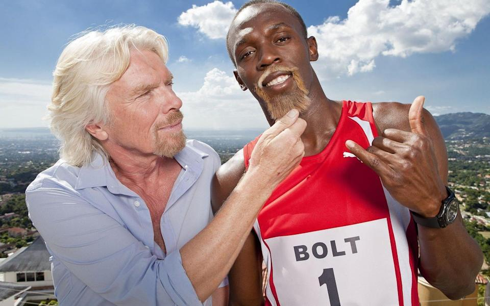 Usain Bolt appearing with a Sir Richard Branson-style beard - PA
