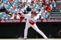 Los Angeles Angels designated hitter Shohei Ohtani strikes out swinging against the Seattle Mariners during the first inning of a baseball game in Anaheim, Calif., Sunday, July 18, 2021. (AP Photo/Alex Gallardo)