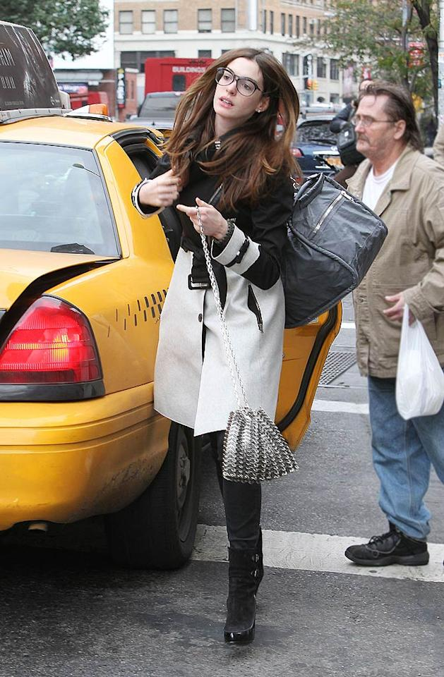 "Looking very ""Devil Wears Prada"" (after the makeover), actress Anne Hathaway grabbed a taxi in New York City's SoHo neighborhood on Wednesday.    (10/26/2011)"
