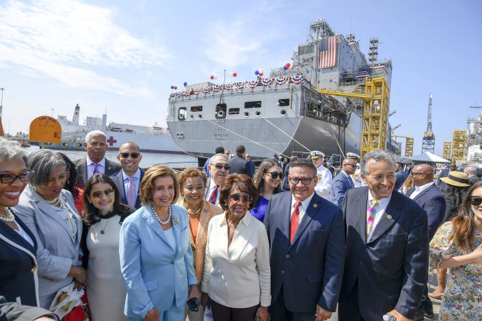 Speaker of the House Nancy Pelosi, center-left, poses for a photo with dignitaries in front of the USNS John Lewis after a christening ceremony Saturday July 17, 2021, in San Diego. (AP Photo/Denis Poroy)