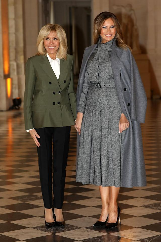 <p>Melania Trump attends a Head of States partner luncheon with Brigitte Macron to mark the 100th anniversary of the armistice that ended World War I. The First Lady draped a gray coat over a pleated gray dress, both by Dior. </p>