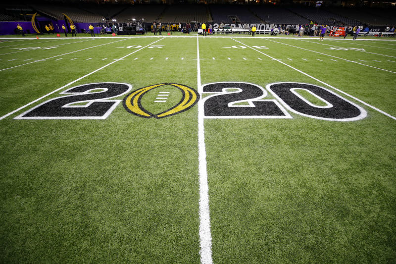 The CFB 2020 logo is displayed on the field prior to the College Football Playoff title game between LSU and Clemson on Jan. 13, 2020. (Todd Kirkland/Icon Sportswire via Getty Images)