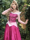 <p>Every part of this pink ensemble is positively dreamy. To re-create the look, invest in a dress, necklace, and wig. </p>
