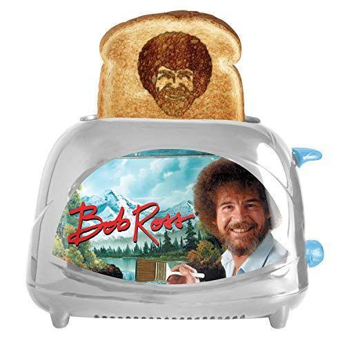 """<p><strong>BobRoss</strong></p><p>amazon.com</p><p><strong>$34.99</strong></p><p><a href=""""http://www.amazon.com/dp/B07GZ2LX28/?tag=syn-yahoo-20&ascsubtag=%5Bartid%7C10055.g.4711%5Bsrc%7Cyahoo-us"""" rel=""""nofollow noopener"""" target=""""_blank"""" data-ylk=""""slk:Shop Now"""" class=""""link rapid-noclick-resp"""">Shop Now</a></p><p>Each day will start with a smile (and a giggle) after they catch a glimpse of Bob's iconic curls. Who knows, their avocado toast might even inspire them to pick up a paintbrush after a day's work.</p>"""