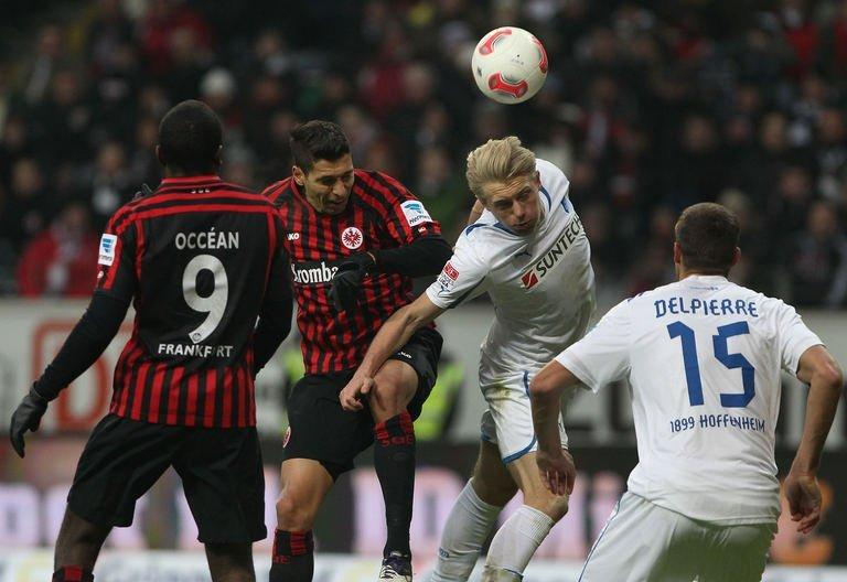 L-R: Frankfurt's forward Olivier Occean and midfielder Karim Matmour fight for the ball with Hoffenheim's defenders Andreas Beck and Matthieu Delpierre during a German first division Bundesliga football match in Frankfurt am Main, western Germany, on January 26, 2013. Eintracht Frankfurt stayed in the chasing pack with a 2-1 home win over Hoffenheim