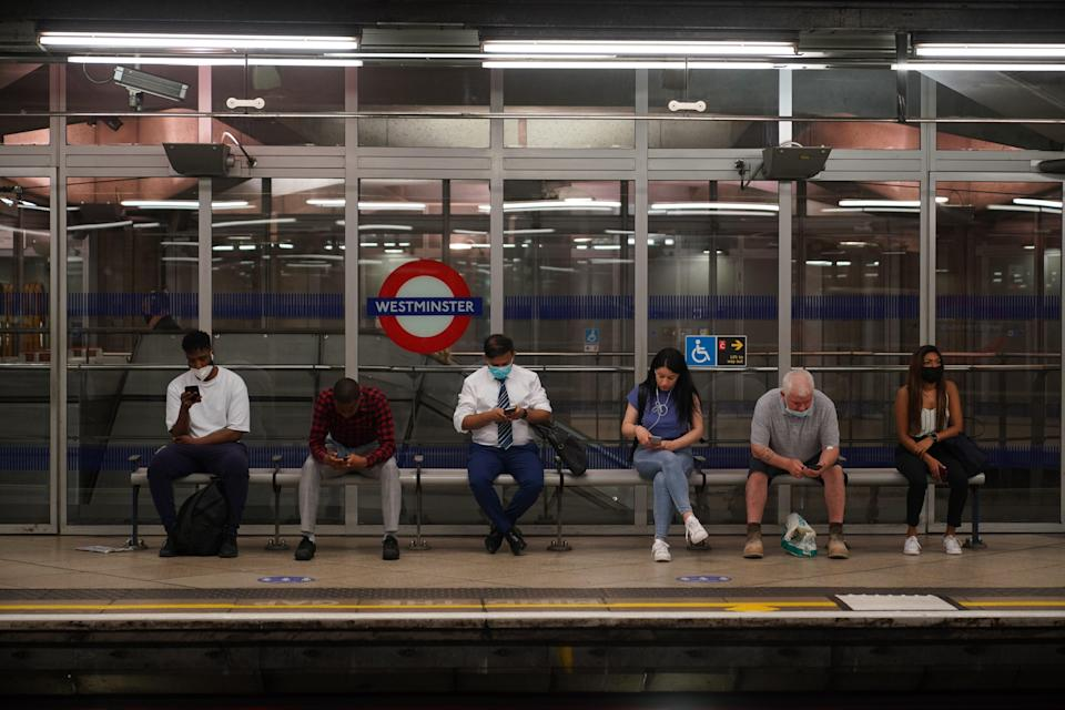 Commuters, some not wearing facemasks, at Westminster Underground station in London after the final legal coronavirus restrictions were lifted in England (Yui Mok/PA) (PA Wire)