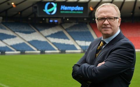 """Craig Brown added his voice to the calls for Hampden Park to remain Scotland's home ground, as the Scottish Football Association consider whether or not to buy the stadium from its current owners, Queens Park. An agreement for a purchase in principle was agreed recently but, as Telegraph Sport revealed this week, some on the SFA board have yet to be convinced that their organisation should take on the task of stadium ownership. Their counterparts at the Scottish Rugby Union own Murrayfield and have been lobbying hard for that Edinburgh ground to stage international football. Hearts played at Murrayfield earlier this season while the main stand at their Tynecastle home was reconstructed and Brown, a non-executive director at Aberdeen, sampled the ground first-hand when the Pittodrie side visited in September. """"The atmosphere wasn't what you would want for a football match,"""" Brown said. Leader: Alex McLeish is unveiled by the SFA as the new Scotland National Team manager at Hampden Park Credit: Getty """"The Hearts folk would definitely agree with that. Look at the upturn in their form when they went back to Tynecastle. They were yearning to get back to Tynecastle and they kept saying it. Craig Levein said that their fortunes would change when they got back – and they did. """"Murrayfield has a great atmosphere for the rugby but our fans were so far behind the goals they needed a telescope to see the game. """"We've surely got to be ambitious enough to own our own stadium. Hampden is a stadium of neutrality for cup semi-finals and finals. If they get a good new surface you can play under-21 games, which you couldn't do the day before senior internationals, because the schedule for the U-21s is now different. """"You can't live in the past. You've got to look forward, but Hampden is the spiritual home of Scottish football. It needs a wee bit of revamping if we can afford it. What an impact it would make if Ian Maxwell, the new SFA chief executive, could do that, but the purse stri"""