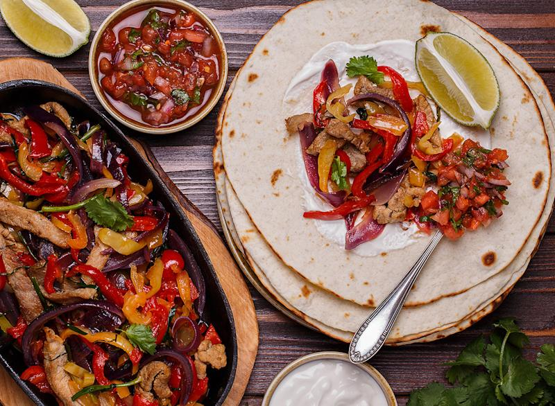 Fajitas with sour cream on the tortilla