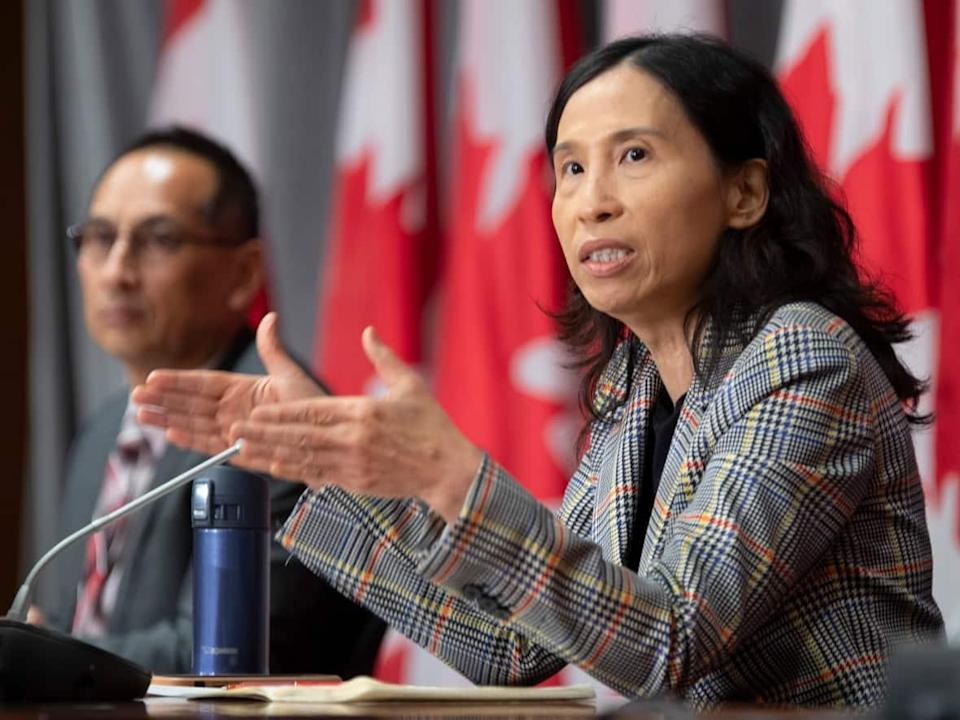 Deputy Chief Public Health Officer Howard Njoo looks on as Chief Public Health Officer Theresa Tam responds to a question during a news conference Friday, September 11, 2020 in Ottawa. (Adrian Wyld/The Canadian Press - image credit)