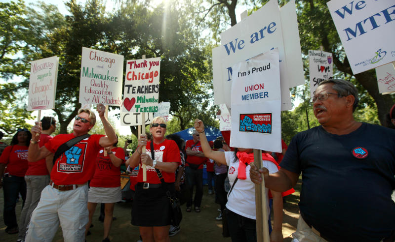 "Teachers from Wisconsin and Minnesota join striking Chicago teachers during a rally Saturday, Sept. 15, 2012, in Chicago. Union president Karen Lewis reminded the crowd that although there is a ""framework"" for an end to their strike, they still are on strike. (AP Photo/Sitthixay Ditthavong)"