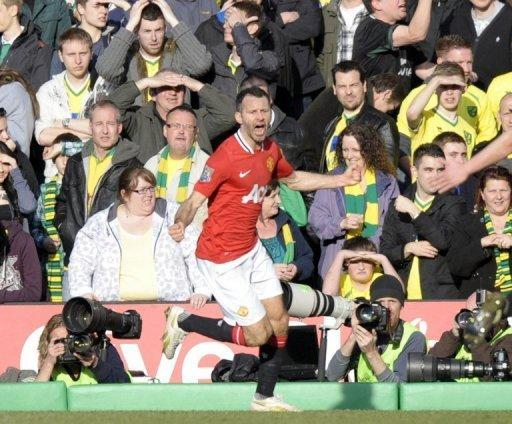 Manchester United's Ryan Giggs (C) celebrates acfter scoring the winning goal during the Premier League match against Norwich City February 26. Giggs' goal in the second minute of stoppage time earned United a 2-1 win at Norwich City on Sunday
