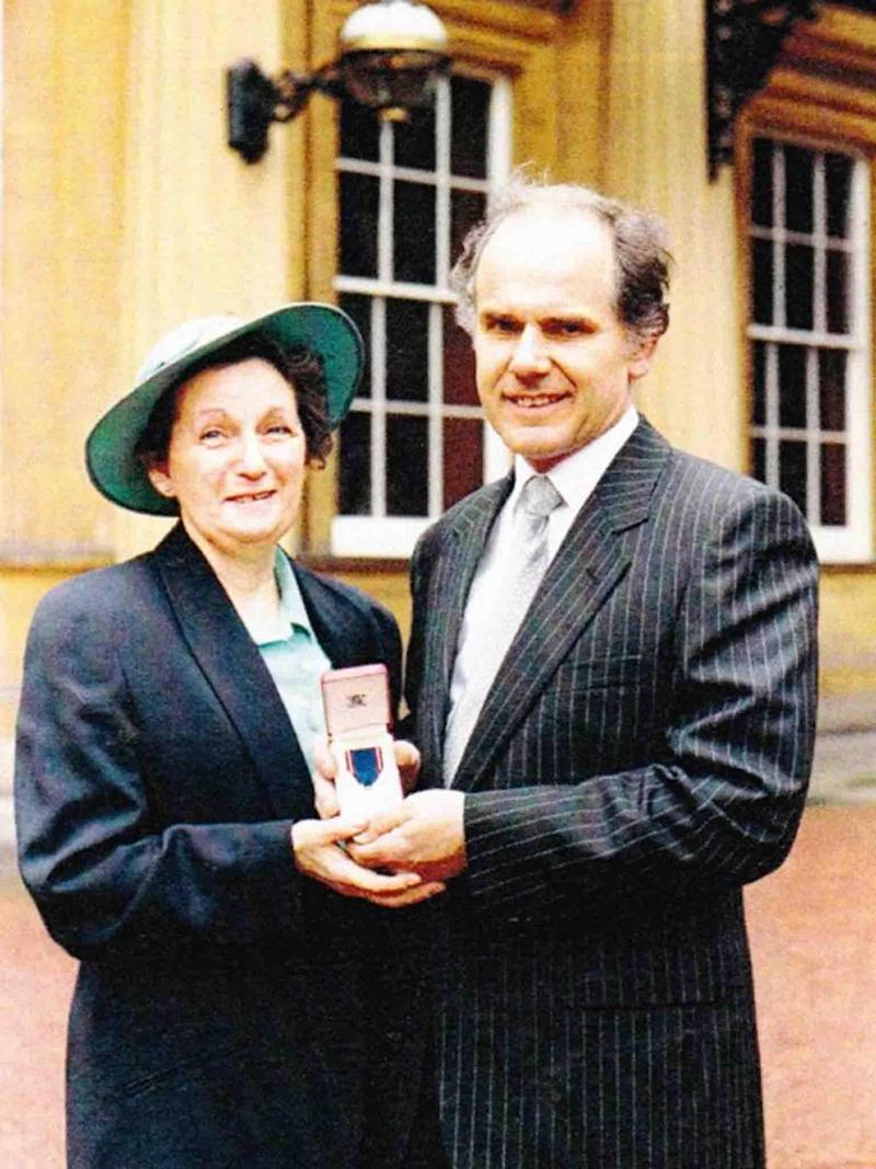 Mr Skerritt at Buckingham Palace with wife, Patricia, after receiving his Royal Victorian Medal in 1991