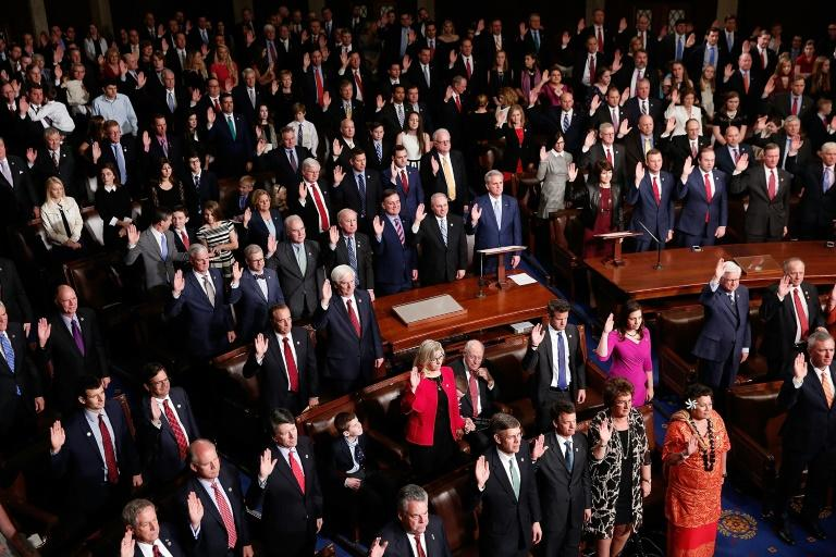 US lawmakers, seen taking the oath of fofice in January 2017, are up against a hard deadline of funding federal operations by April 28, 2017 at midnight, or face a government shutdown