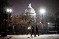 People walk through the snow on Capitol Hill