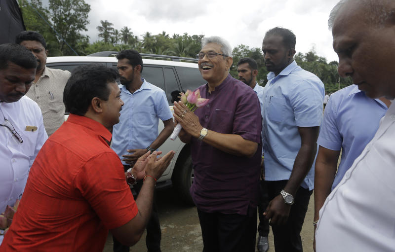 Sri Lankan presidential candidate and former defense chief Gotabaya Rajapaksa is received by supporters in Neluwa village in Galle, Sri Lanka, Tuesday, Oct. 22, 2019. The daughter of a Sri Lankan journalist assassinated during the country's civil war says she'll appeal a U.S. court's decision to throw out her lawsuit against Rajapaksa, the front-runner in Sri Lanka's upcoming presidential election. Rajapaksa was defense chief when Lasantha Wickrematunge, editor of the Sunday Leader newspaper, was killed in January 2009, around four months before the end of the long civil war. (AP Photo/Eranga Jayawardena)