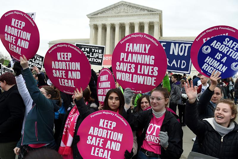 Anti-abortion and abortion rights activists square off outside the U.S. Supreme Court in Washington. Under the high court's new conservative majority, abortion rights are in jeopardy. (Photo: OLIVIER DOULIERY/AFP via Getty Images)