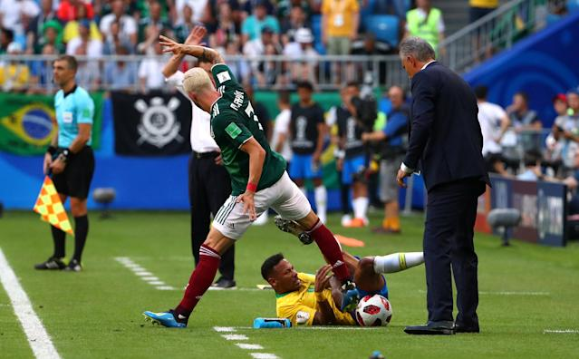 <p>Mexico's Miguel Layun and Brazil's Neymar during the match REUTERS/Michael Dalder </p>