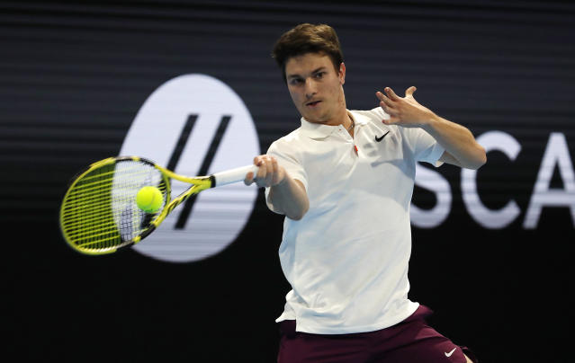Miomir Kecmanovic, of Serbia, returns the ball to Casper Ruud, of Norway, during the ATP Next Gen tennis tournament final, in Milan, Italy, Tuesday, Nov. 5, 2019. (AP Photo/Antonio Calanni)