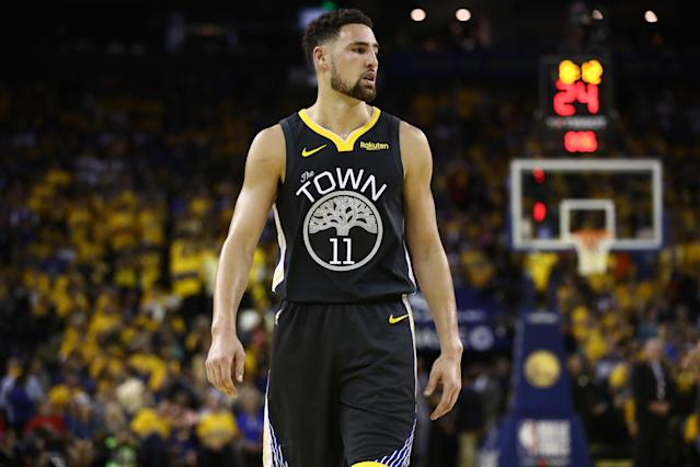 "Klay Thompson is nursing an injury, but his crutches didn't stop him from visiting the set of ""Space Jam 2."" (Photo by Ezra Shaw/Getty Images)"