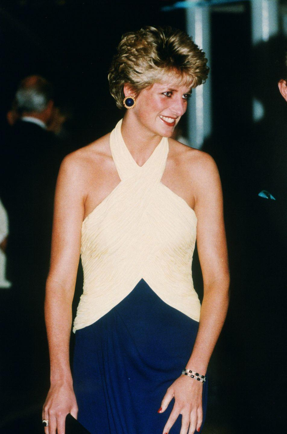 <p>Although the colors in Princess Diana's Catherine Walker halter-top gown are the reverse of Snow White's, the unique color combination makes it hard not to compare her to the fairest of them all. </p>