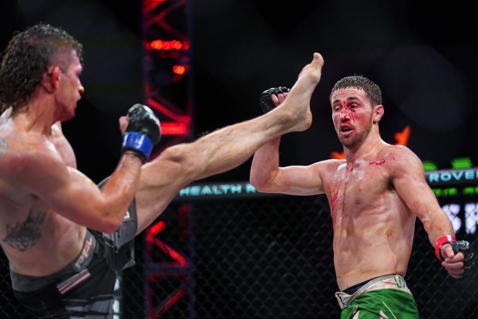 Brendan Loughnane, right, doges a kick by Tyler Diamond during a Professional Fighters League mixed martial arts bout in Atlantic City, N.J., Thursday, June 10, 2021. (AP Photo/Matt Rourke)