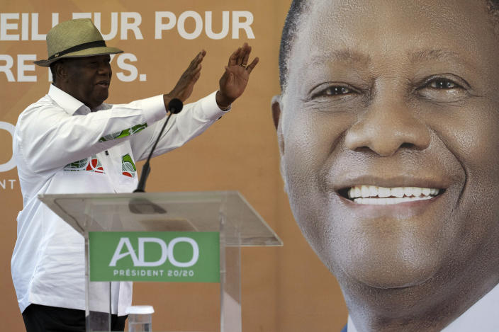Ivory Coast President Alassane Ouattara waves to supporters before speaking at a rally in Anyama, outskirts of Abidjan, Ivory Coast, Wednesday, Oct. 28, 2020. Ouattara, who first came to power after the 2010 disputed election whose aftermath left more than 3,000 people dead, is now seeking a third term in office. The candidate maintains that he can serve a third term because of changes to the country's constitution, though his opponents consider his candidacy illegal. (AP Photo/Leo Correa)