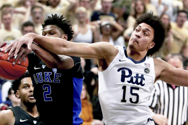 Pittsburgh's Kene Chukwuka (15) and Duke's Cam Reddish (2) vie for s rebound during the first half of an NCAA college basketball game, Tuesday, Jan. 22, 2019, in Pittsburgh. (AP Photo/Keith Srakocic)