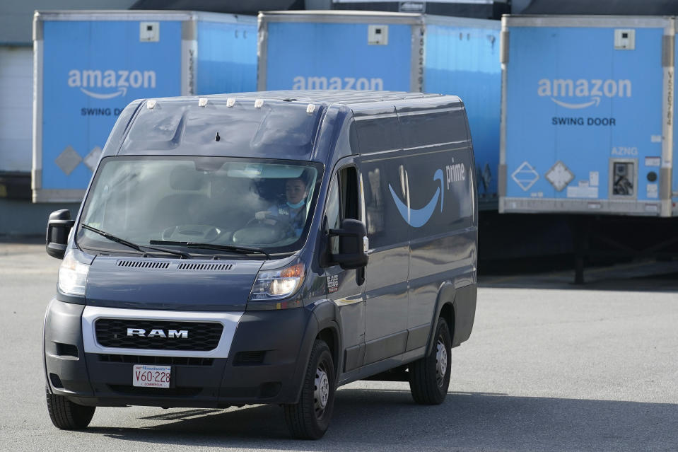 An Amazon delivery van departs an Amazon Warehouse location, Thursday, Oct. 1, 2020, in Dedham, Mass. (AP Photo/Steven Senne)