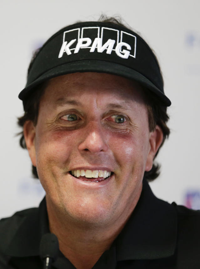 Phil Mickelson talks to the media during a news conference at the Farmers Insurance Open golf tournament at Torrey Pines Golf Course on Wednesday, Jan. 22, 2014, in San Diego. (AP Photo/Chris Carlson)