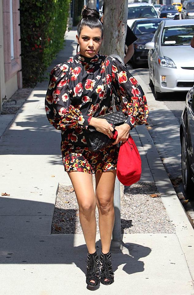 "With Kim's fairytale wedding just a week away, her sisters -- Kourtney and Khloe -- had to get their bridesmaids dresses in order. First up, we have Kourtney, who was spotted heading to the Vera Wang shop in Beverly Hills in this floral flub, fringe-adorned booties, and abysmal bun. Hopefully the ensemble she has selected for next weekend won't warrant another appearance in What Were They Thinking?!. Clint Brewer/<a href=""http://www.splashnewsonline.com"" target=""new"">Splash News</a> - August 10, 2011"
