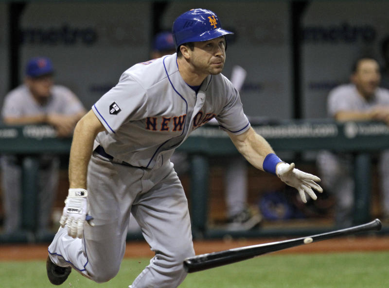 New York Mets' Vinny Rottino flips his bat after hitting a sixth-inning RBi double off Tampa Bay Rays starting pitcher David Price during an interleague baseball game Wednesday, June 13, 2012, in St. Petersburg, Fla. (AP Photo/Chris O'Meara)