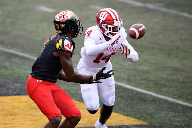 Maryland wide receiver Dontay Demus Jr. (7) watches the ball as Indiana defensive back Andre Brown Jr. (14) moves in during the first half of an NCAA college football game, Saturday, Oct. 19, 2019, in College Park, Md. Demus Jr. caught the ball for a touchdown on the play. (AP Photo/Nick Wass)
