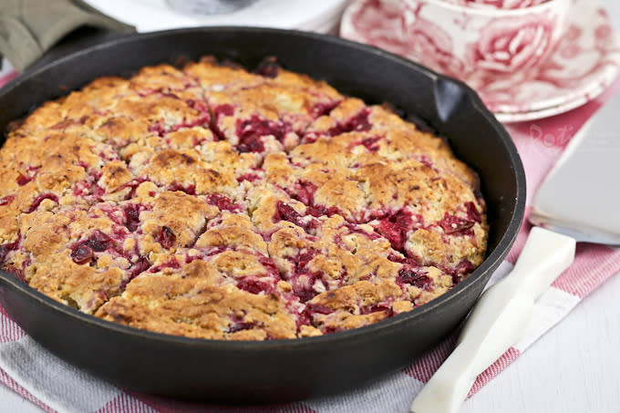 "<p>You're almost guaranteed to have leftover cranberry sauce after your holiday meal so turn it into this no-fuss skillet scone! The dough can be whipped up in a food processor. Simply fold in the cranberry sauce, transfer to a cast iron skillet and into the oven it goes!<br> Get the recipe <a href=""http://www.rotinrice.com/2014/12/cranberry-sauce-skillet-scones/"" rel=""nofollow noopener"" target=""_blank"" data-ylk=""slk:here"" class=""link rapid-noclick-resp""><strong>here</strong></a><br>[Photo: Roti & Rice] </p>"