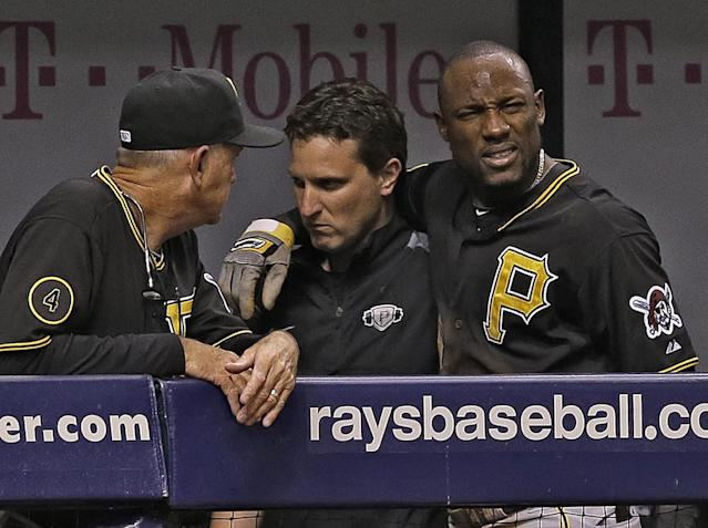 Pittsburgh Pirates' Starling Marte, right, is helped to the clubhouse after getting injured attempting to steal second base during the fifth inning of an interleague baseball game against the Tampa Bay Rays, Tuesday, June 24, 2014, in St. Petersburg, Fla. (AP Photo/Chris O'Meara)