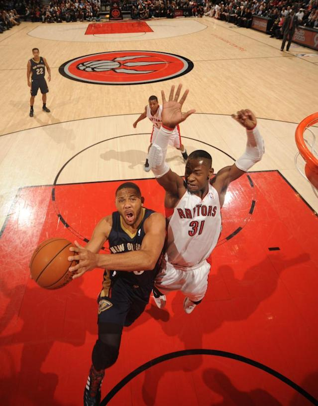 TORONTO, CANADA - February 10: Eric Gordon #10 of the New Orleans Pelicans going up for a lay up during a game against the Toronto Raptors on February 10, 2014 at the Air Canada Centre in Toronto, Ontario, Canada. (Photo by Ron Turenne/NBAE via Getty Images)