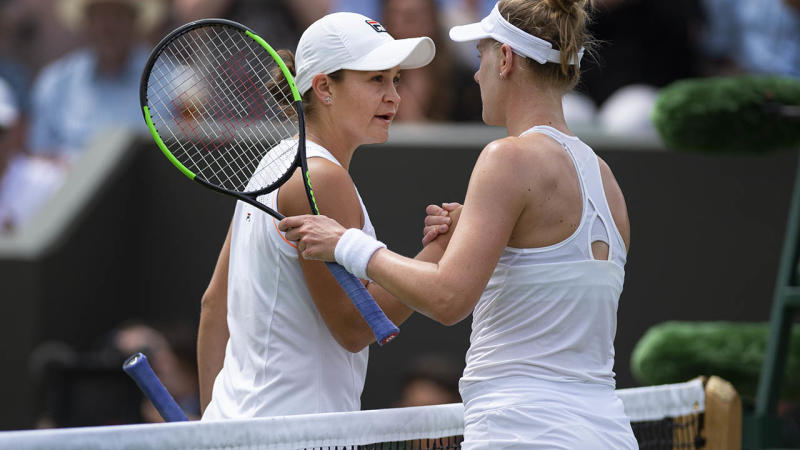 Alison Riske and Ashleigh Barty shake hands after their match at Wimbledon. (Photo by Visionhaus/Getty Images)