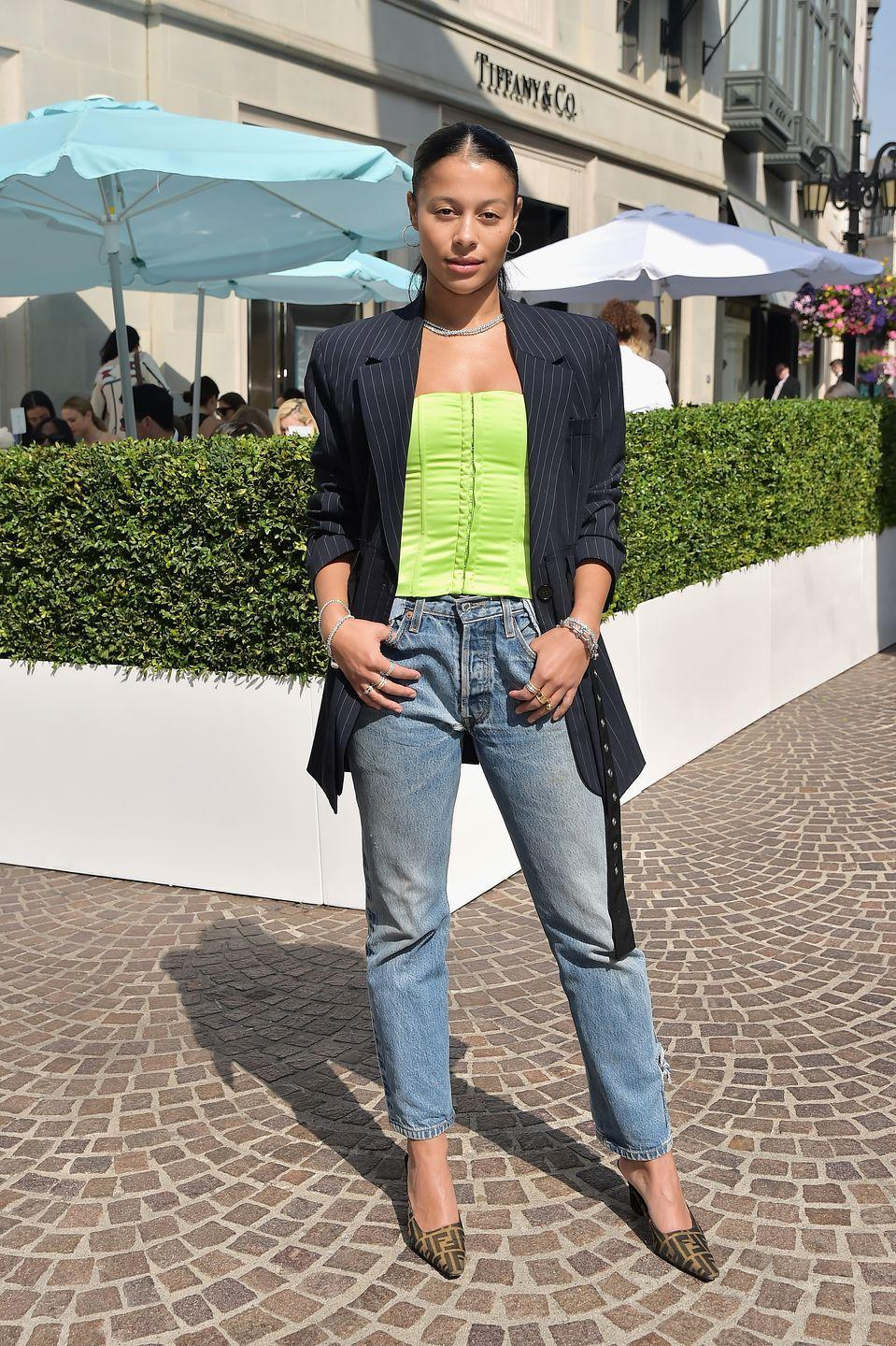 <p>This look utilizes your internship staples, but still looks freakin' trendy due to the bustier top and glitzy choker.</p>