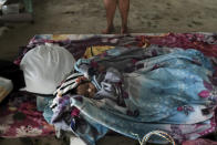 A baby sleeps in a makeshift shelter during the passage of Hurricane Iota in Siuna, Nicaragua, Tuesday, Nov. 17, 2020. Hurricane Iota tore across Nicaragua on Tuesday, hours after roaring ashore as a Category 4 storm along almost exactly the same stretch of the Caribbean coast that was recently devastated by an equally powerful hurricane. (AP Photo/Carlos Herrera)