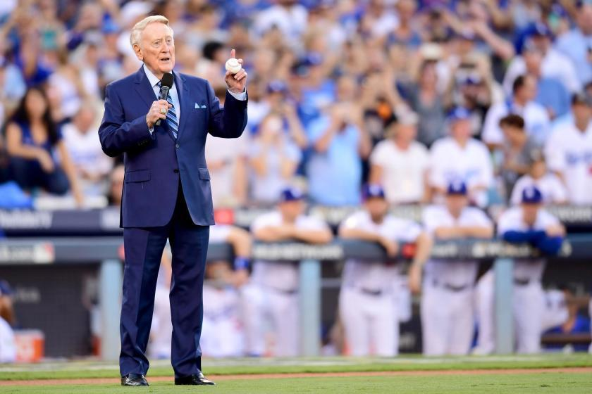 "Former Dodgers broadcaster Vin Scully speaks during a pregame ceremony at Dodger Stadium. <span class=""copyright"">(Harry How / Getty Images)</span>"