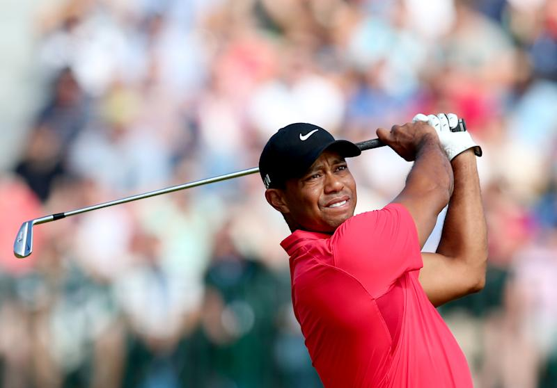 US golfer Tiger Woods watches his shot from the 4th tee during his fourth round, on the final day of the British Open at Royal Liverpool Golf Course in Hoylake, northwest England, on July 20, 2014