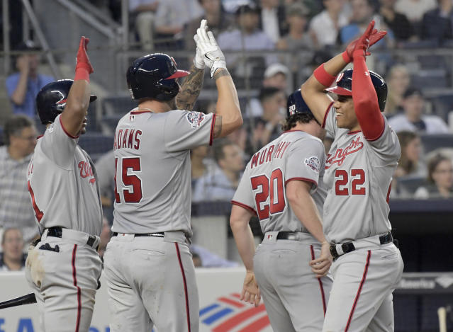 Washington Nationals right fielder Juan Soto (22) celebrates his three-run home run with Matt Adams (15), Wilmer Difo (1) and Daniel Murphy (20) during the fourth inning of a baseball game against the New York Yankees on Wednesday, June 13, 2018, at Yankee Stadium in New York. (AP Photo/Bill Kostroun)