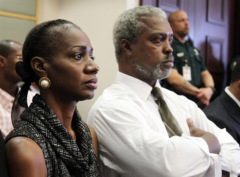 Pam,left, and Robert Champion Sr. look at defendant Brian Jones, Monday, Oct. 22, 2012 as Jones apologizes to them before being sentenced in a Orlando, Florida courtroom in Florida A&M University hazing incident. Jones was given six months of community control, which strictly limits his freedom with measures including an ankle monitor and frequent check-ins with probation officials. (AP Photo/POOL, Red Huber)