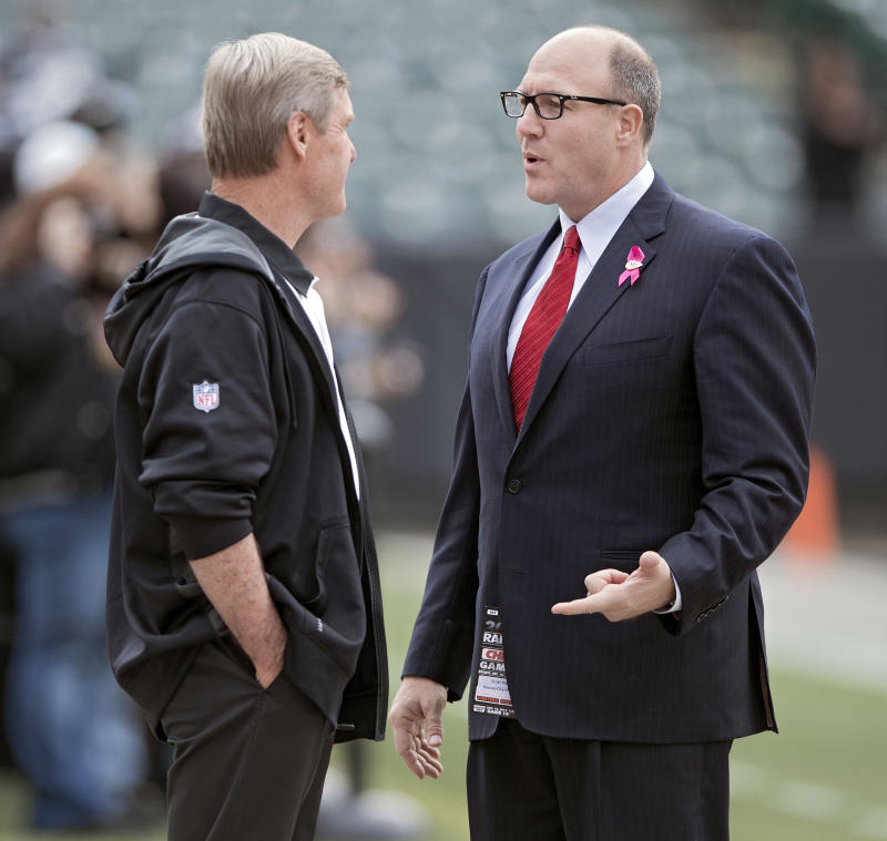 Scott Pioli, right, has been recognized by the NCAA for his work to advance diversity and inclusion in sports. (Getty Images)