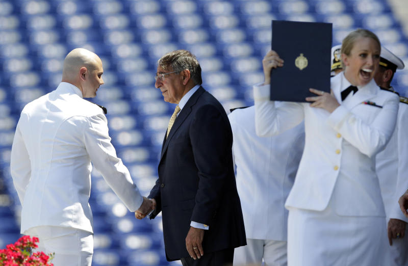 Secretary of Defense Leon Panetta, center, shakes hands with a United States Naval Academy Midshipmen as a fellow Midshipman, right, reacts after receiving her diploma during the Academy's graduation and commissioning ceremonies in Annapolis, Md., Tuesday, May 29, 2012. The Pentagon chief said Tuesday building U.S. maritime strength across the Asia-Pacific region will be one of the main projects for the new generation of America's naval officers. (AP Photo/Patrick Semansky)