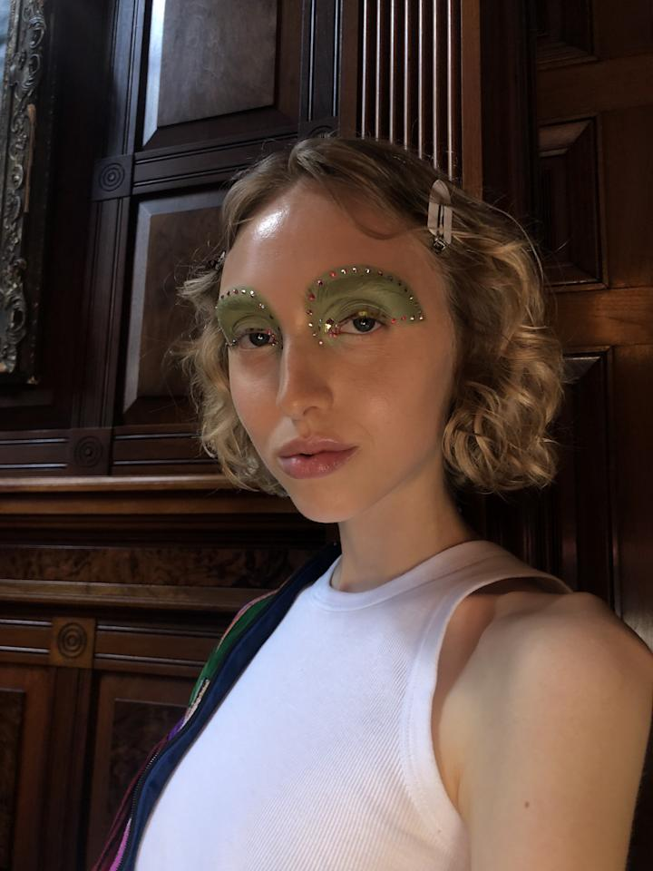 """This season was all about individuality - which spoke through everything from the clothing to the hair and make-up. Pat McGrath devised 60 unique make-up looks inspired by a whole cast of characters (Jane Fonda, Barbara Streisand, Twiggy). The looks were all about """"an idealized interpretation of real life."""" McGrath explains, """"There is a nod to the past and future. What's great is taking the looks that come from the past but modernizing them."""". Rhinestones, cellophane, and glitter were used throughout to our delight."""