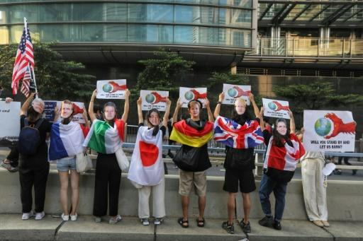 Some of the pro-democracy Hong Kong activists wore masks depicting various world leaders during the peaceful march to the US consulate, in a bid to increase pressure on China
