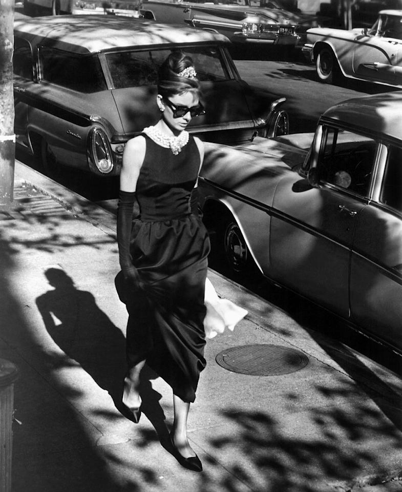 <p>Hepburn on the set of the movie <em>Breakfast at Tiffany's</em>, wearing the unforgettable little black Givenchy dress. (Photo: Getty Images) </p>