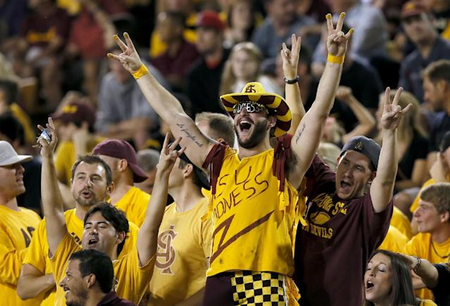 Arizona State fans cheer after an early touchdown against Colorado during the first half of an NCAA college football game on Saturday Oct. 12, 2013, in Tempe, Ariz. (AP Photo/Ross D. Franklin)