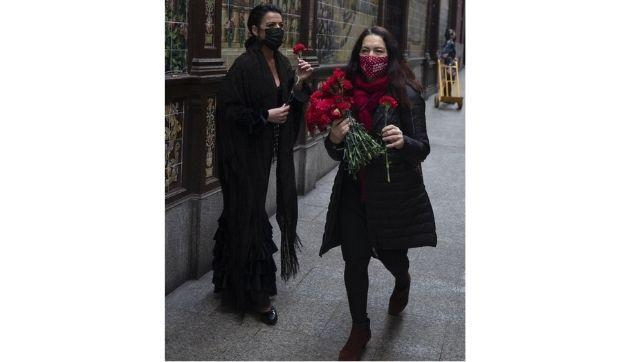 Spanish Flamenco dancer Anabel Moreno is given a rose outside the Villa Rosa Tablao flamenco venue during a protest in Madrid, Spain. Photo credit: AP Photo/Paul White.